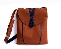 С чем носить рыжую сумку?
