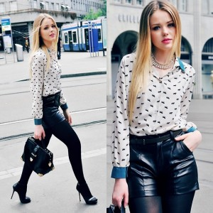 Девушка в блузке и в черных шортах