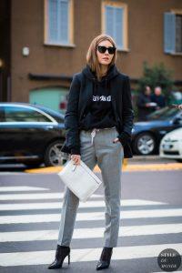Девушка на улице на пешеходном переходе в худи и в серых брюках